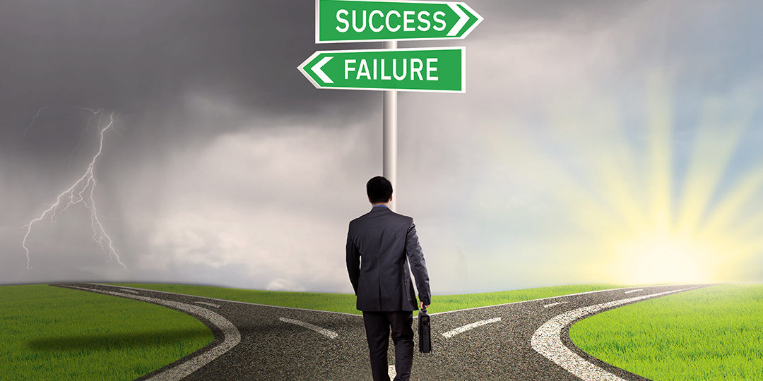 Man standing before success failure sign